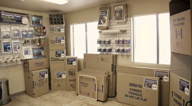 Inside facility office with moving and packing supplies available and various moving box sizes