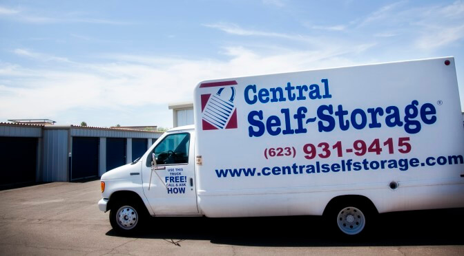 Central Self Storage moving trucks parked outside by outdoor storage units