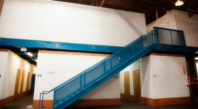 Inside storage facility with a blue staircase leading to more indoor storage units
