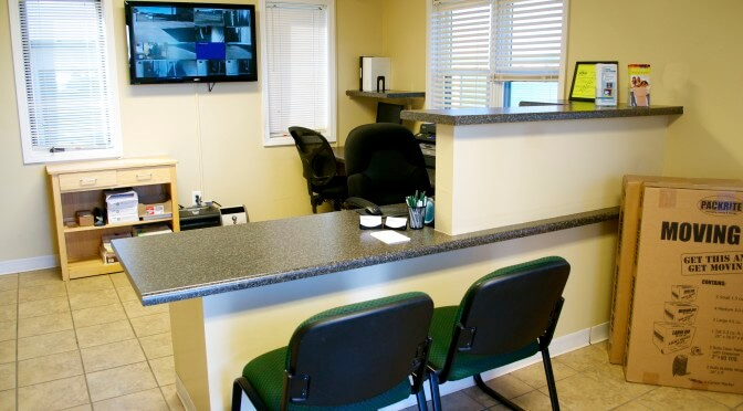 Inside facility office overlooking front desk area with two chairs pulled up to the desk