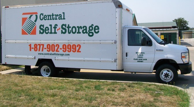 A Central Self Storage moving truck parked outside facility entrance