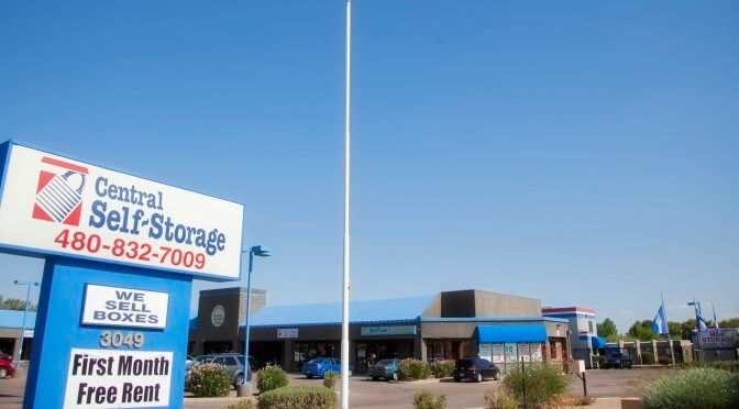 Outdoor view of Central Self Storage signage with promotions for we sell boxes and first month free rent