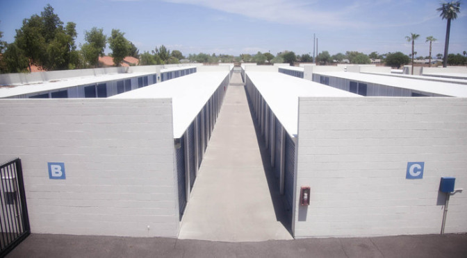 A view overlooking multiple rows of outdoor storage units in a clean environment