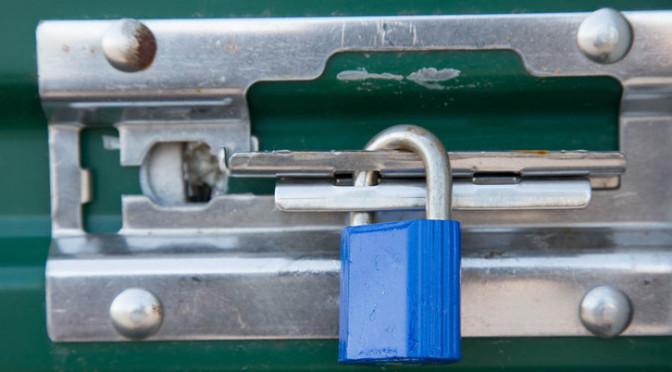 A padlock on a storage door