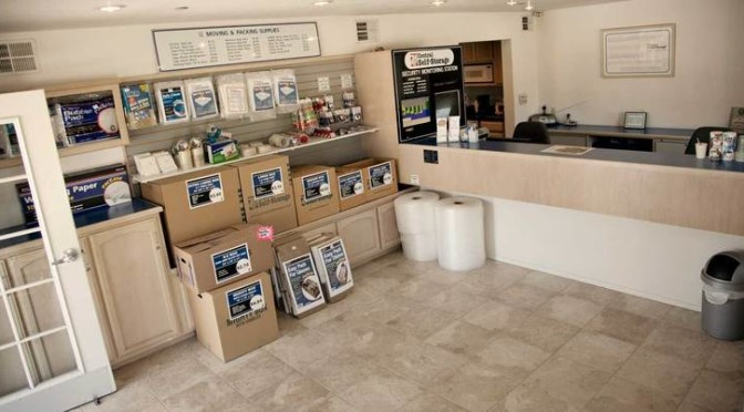 Clean, organized facility office with packing and moving supplies available