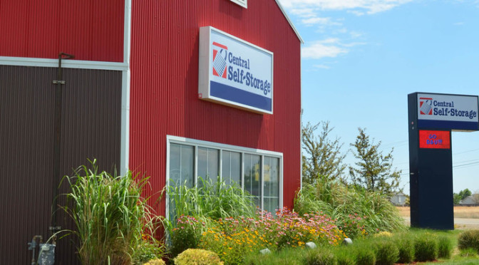 Exterior view of facility building with Central Self Storage signage on the building and on a sign outside of the building