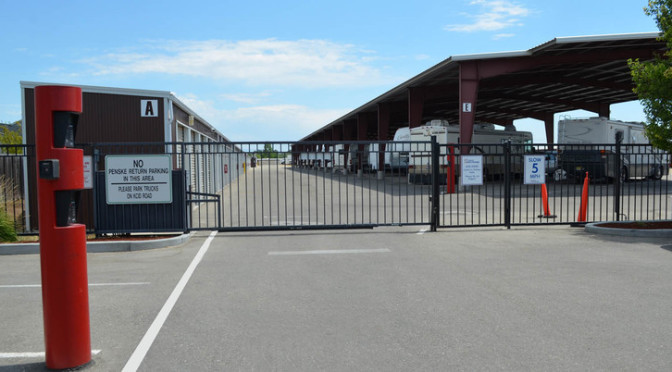 Outside secure gate entrance to outdoor storage units and covered RV parking