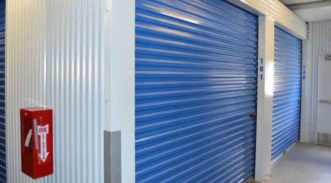Two large indoor storage units with blue doors