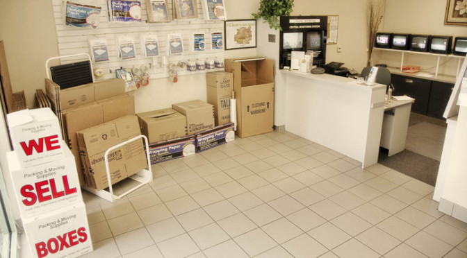 Inside office with moving and packing supplies hanging on the wall and moving boxes for sale