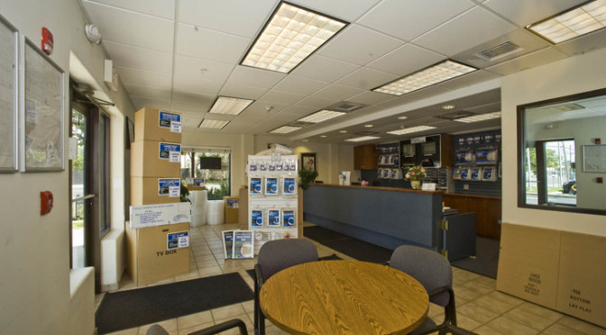 Inside facility office with moving and packing supplies available and a small seating area