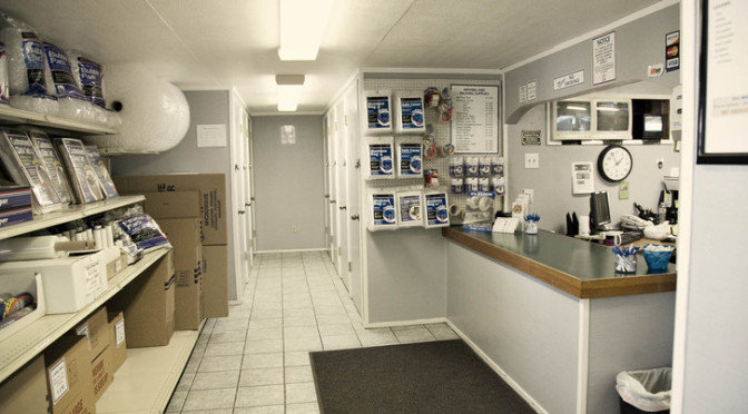 Inside a facility office that is clean with moving and packing supplies available