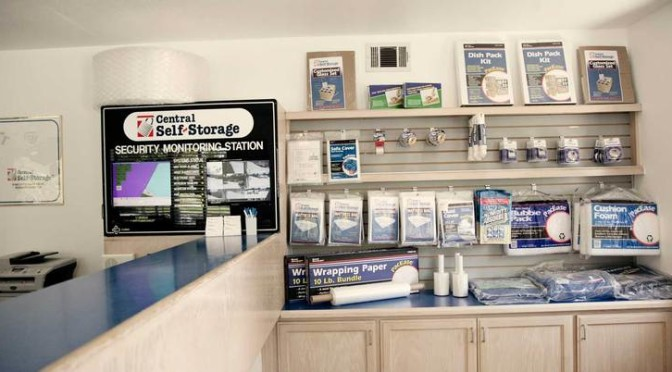 Inside Central Self Storage office overlooking the front desk with moving and packing supplies available