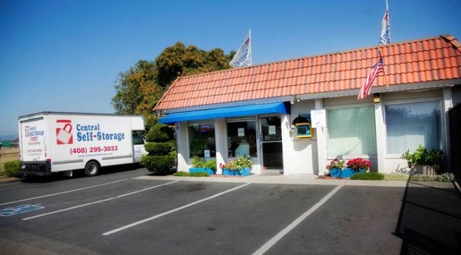 Exterior view of an entrance to A Central Self Storage facility office with a parking lot