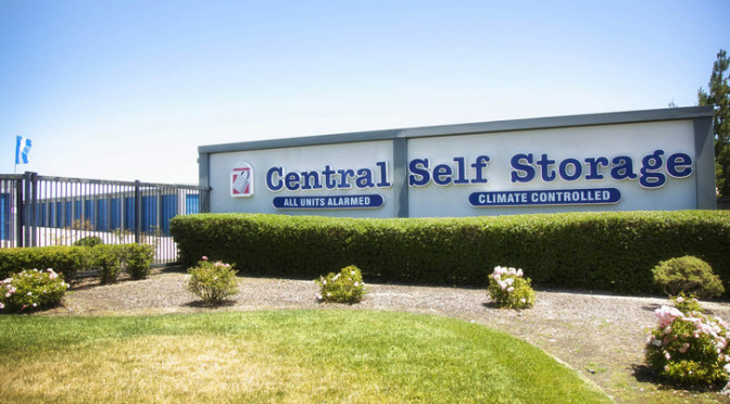 Exterior view of Central Self Storage facility with climate controlled units and units with alarms advertised on building