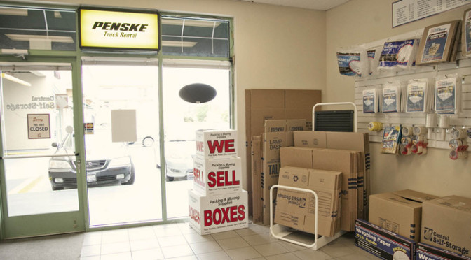 Central Self Storage office with moving and packing supplies available and a Penske Truck Rental sign