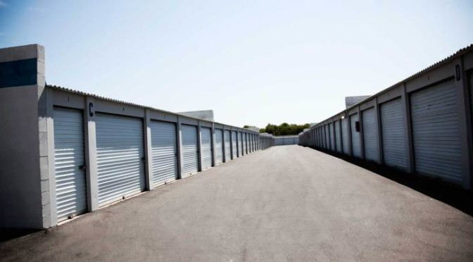 A row of outdoor storage units in a clean environment