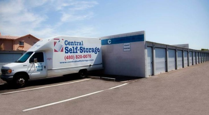 Outdoor storage facilities with a Central Self Storage moving truck parked by the units