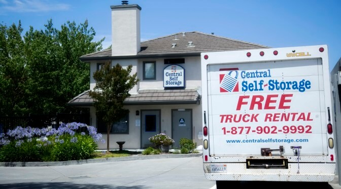 A Central Self Storage moving truck with the promotion free truck rental that is parked in front of storage facility