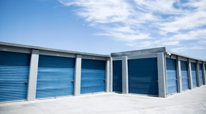 Large outdoor storage units with with blue doors in a clean environment