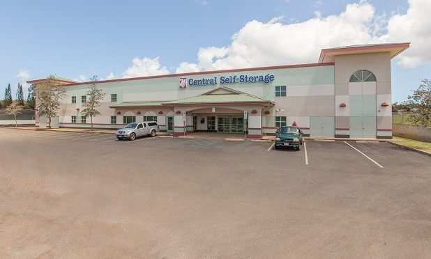 Exterior entrance to Central Self Storage facility with parking