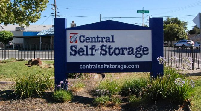 A stand alone sign by the road for a Central Self Storage facility