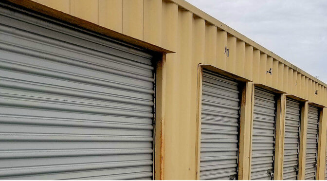View of outdoor storage units with gray doors