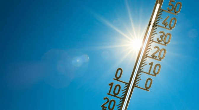 A outdoor thermometer held up to the sun