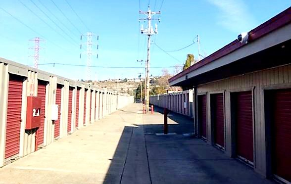 Two rows of drive-up access storage units at Central Self Storage in San Leandro, CA.